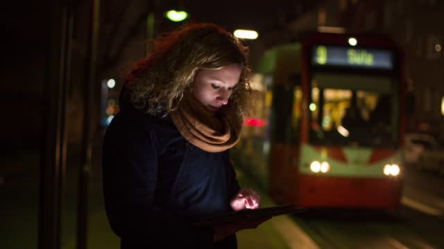 Young Woman Using Digital Tablet on Tram Station video