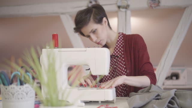 4K: Young Woman Using Her Sewing Machine In Workshop. video