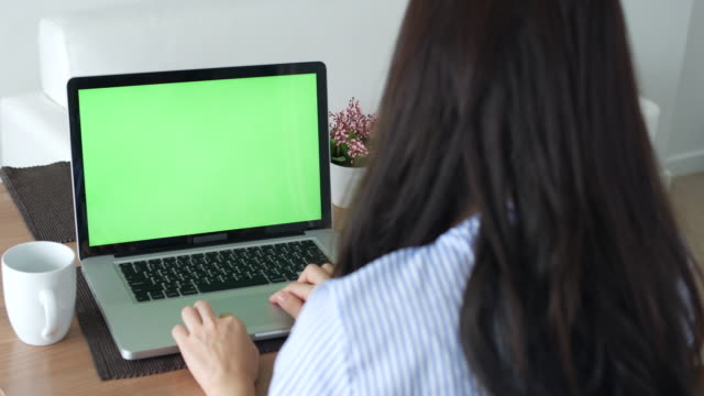 young woman using  labtop green screen at home - online learning stock videos & royalty-free footage