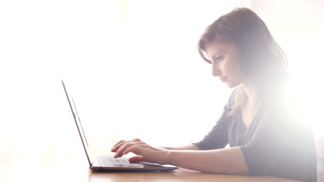 Young woman using laptop video