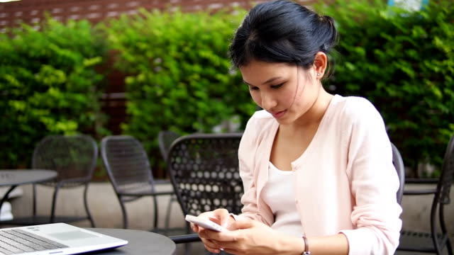 Young woman using mobile phone video