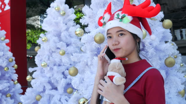 young woman using phone and shopping in Christmas time video