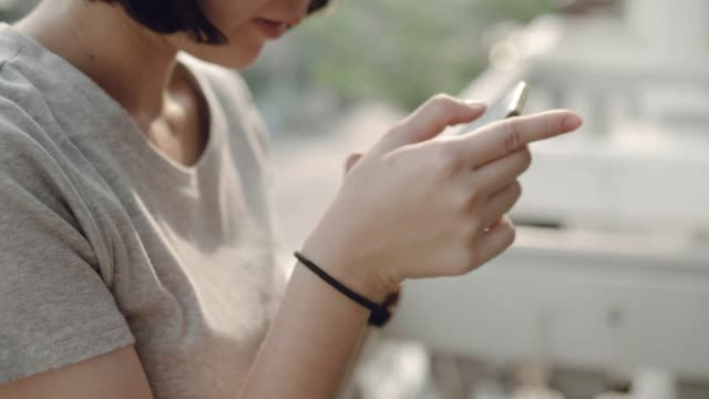 Young woman using smart phone video