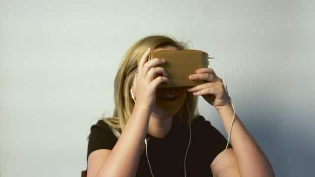 Young Woman Using Virtual Reality Device video