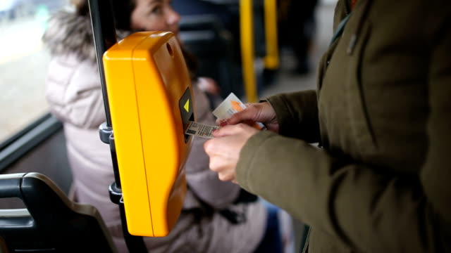 Young woman validating ticket in public transportation video