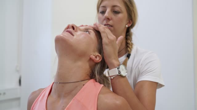Young woman visiting physical therapist video