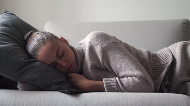 young woman waking up from her sleep to check her phone video