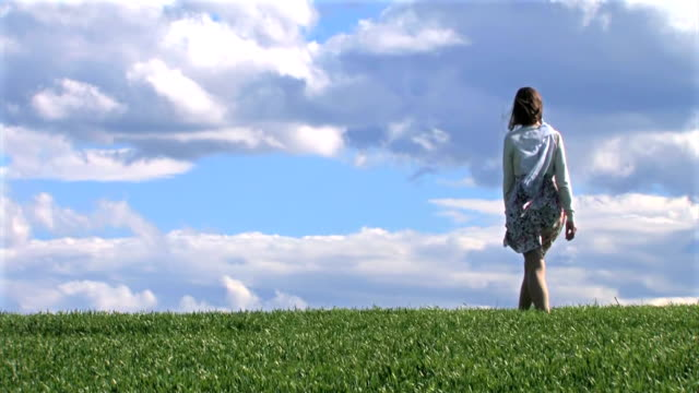 Young Woman Walking on Spring Grass video