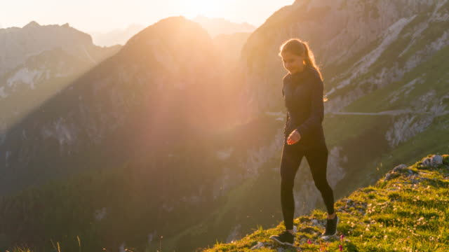 Young woman walking on the edge of a mountain video