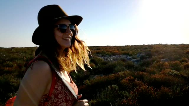 Young woman walking on top of Table Mountain in cape town at sunset HD VIDEO Young woman walking on top of Table Mountain in cape town at sunset HD VIDEO table mountain national park stock videos & royalty-free footage
