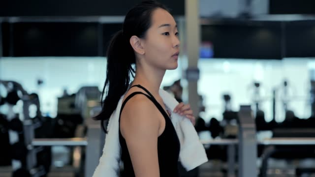 Young woman walking to gym.Woman Working out in the gym.Sport Prep Sport Prep :Young woman walking to gym.Woman Working out in the gym health club stock videos & royalty-free footage