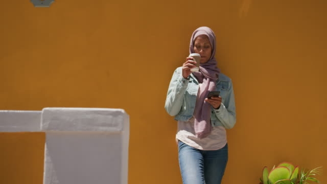 Young woman wearing hijab out and about in the city