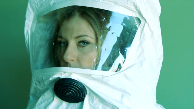 Young woman wearing safety suit. Three quarter view. video