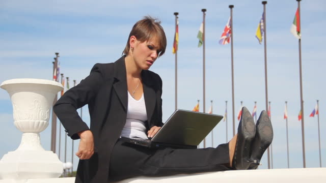 young woman with a laptop video