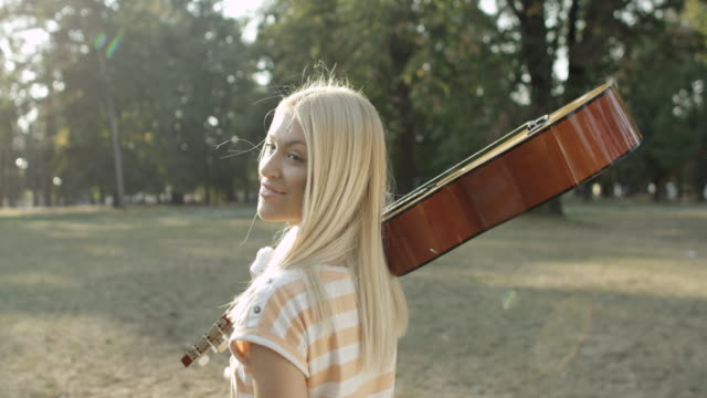 Young woman with acoustic guitar video