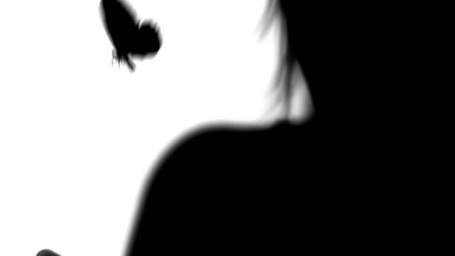 young woman with butterfly silhouettes on white video