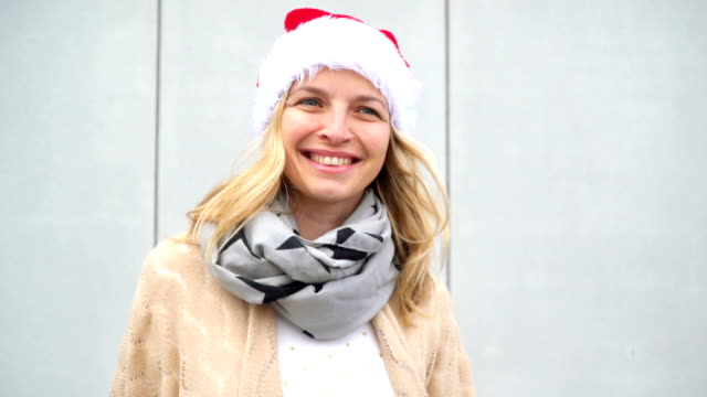 young woman with Christmas cap video