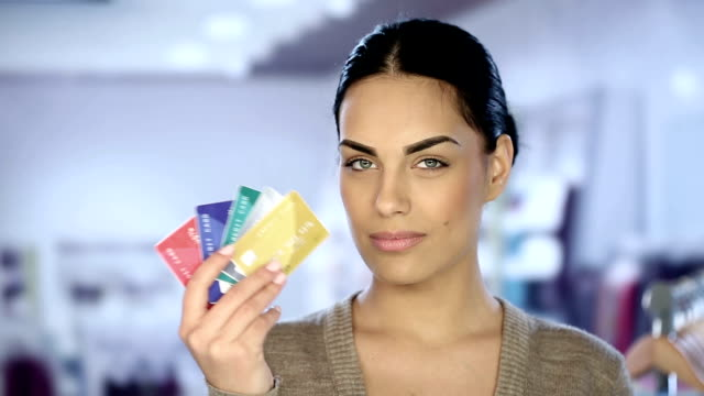 Young woman with credit cards video