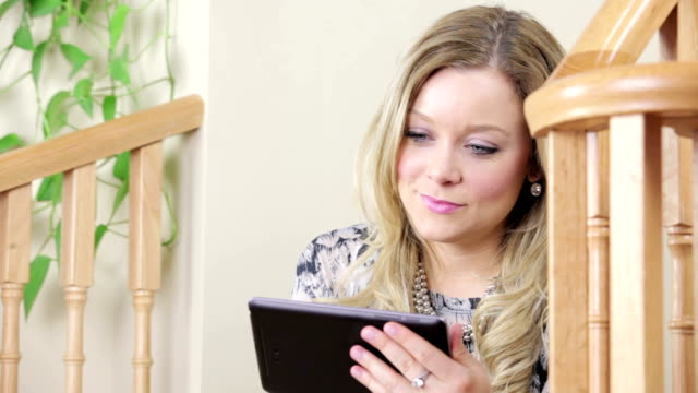 Young woman with digital tablet video