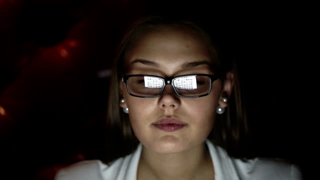 Young woman with glasses who works at night. video