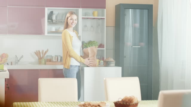 Young woman with groceries video