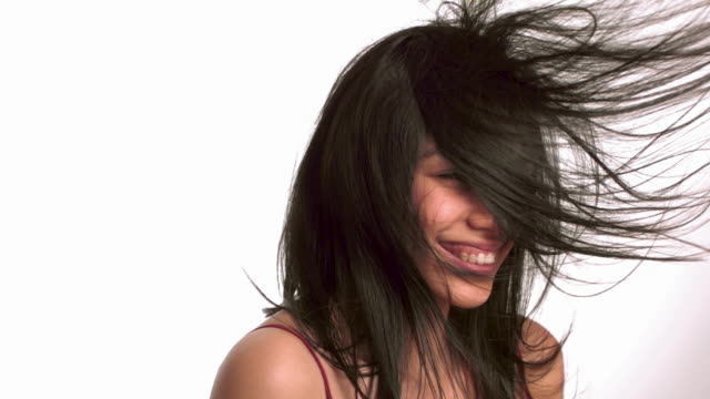Young woman with hair blowing video