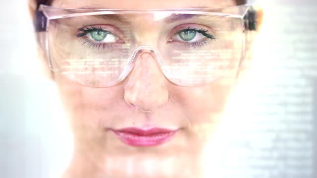 Young woman with holographic glasses. Futuristic. Augmented reality. video