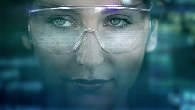 Young woman with holographic glasses. Futuristic. Virtual reality. Dark. video