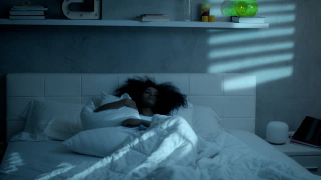Young Woman With Insomnia Trying to Sleep At Night