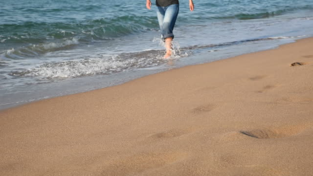 Young Woman With Jeans Walking From The Beach video