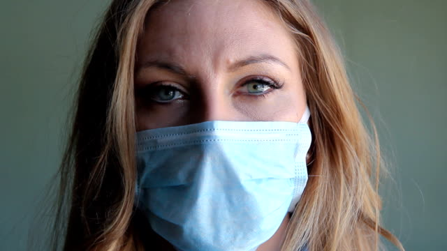 Young woman with medical mask. video