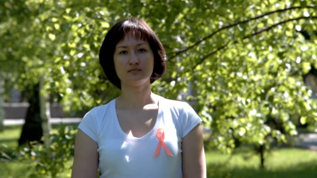 Young woman with orange awareness ribbon video