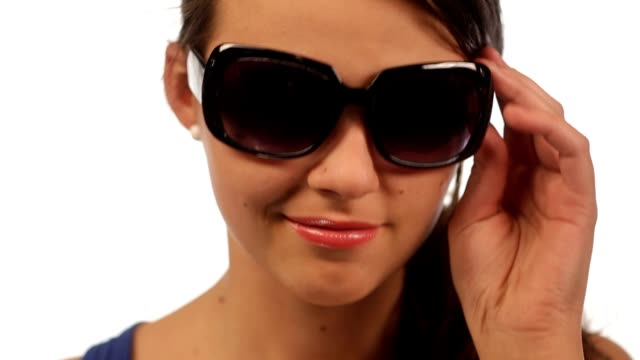 Young woman with sunglasses isolated video