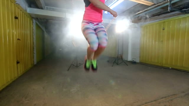 Young woman with the jump rope video
