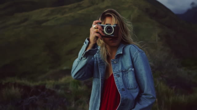 Young Woman with Vintage Camera Taking Pictures video