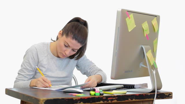 Young woman working in front of the computer. video
