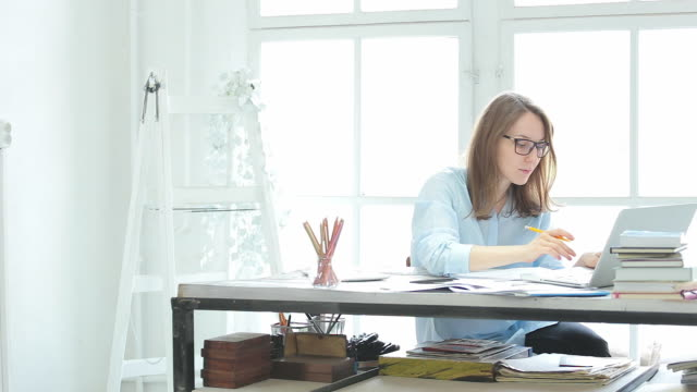 Young woman working in the office. video
