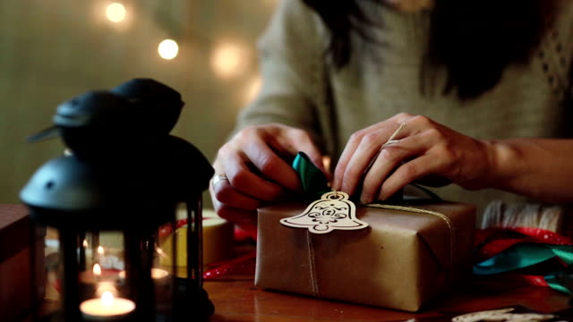 Young Woman Wrapping Christmas Gifts At Home Young Woman Wrapping Christmas Gifts With Brown Paper At Home wrapped stock videos & royalty-free footage
