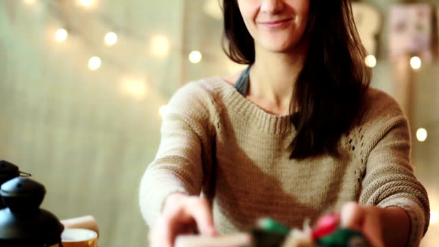 Young Woman Wrapping Christmas Gifts At Home video