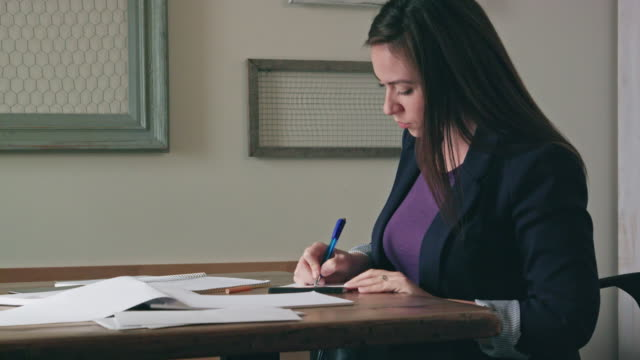 Young Woman Writes on Documents video