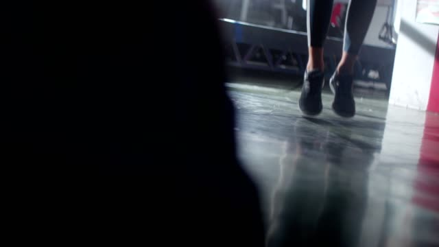 Young woman's feet with trainers while skipping a jump rope Close up of a young woman's feet skipping a jump rope during gym workout cross training stock videos & royalty-free footage
