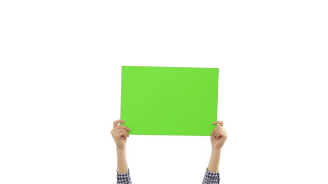 Young woman's hands holding a blank green placard. video