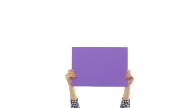 Young woman's hands holding a blank purple placard. video