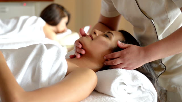 Young women at SPA treatment video