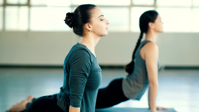 Young women doing exercise video