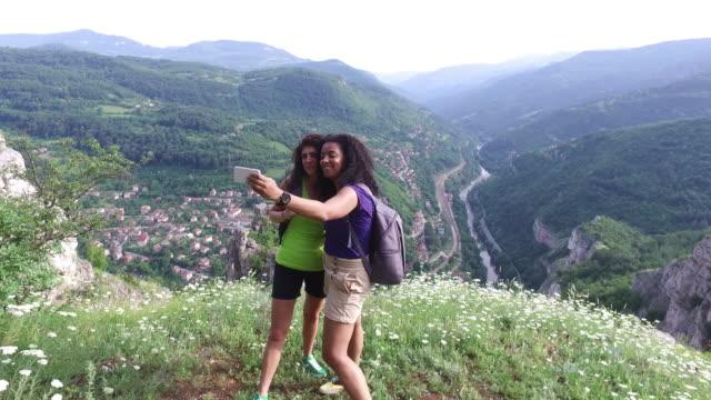 Young women hiking in the mountain
