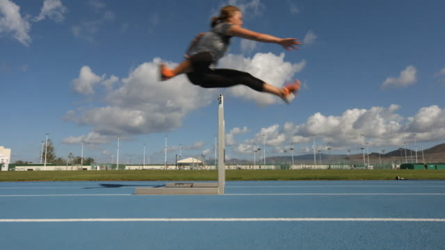 A young women Hurdling in slow motion. video