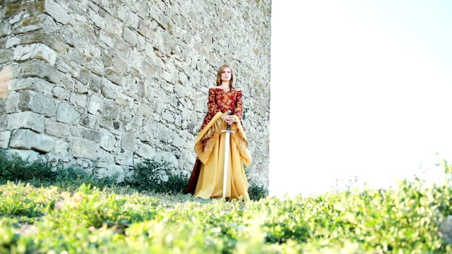 Young women in medieval dress with sword video