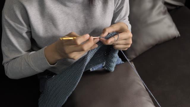 Young women knitting