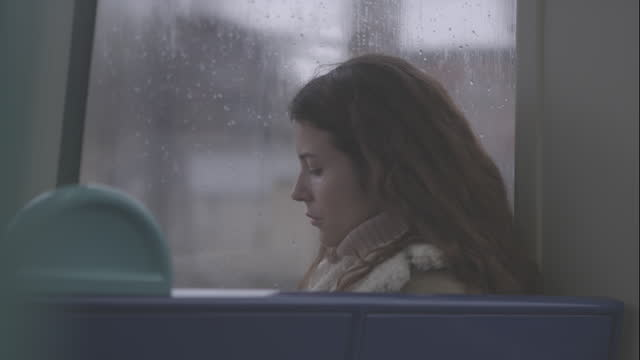 Young Women using Phone on with Public Rail Transport video